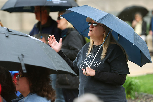 5-6-21<br /> Cindy Smith raises her hand during one of the closing songs at the National Day of Prayer event held on the east side of the Howard County Courthouse.<br /> Tim Bath | Kokomo Tribune