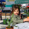 2-year-old Gracelyn Treadway plants a spider plant as part of Little Sprouts at Kokomo Downtown Farmers Market, which opened on Saturday, May 1, 2021 for its 20th season.<br /> Kelly Lafferty Gerber | Kokomo Tribune