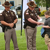 5-6-21<br /> At the Howard County Sheriff Department's annual inspection ceremony on Thursday, eight year-old Hunter Harner shakes hands with Sheriff Jerry Asher after getting an award for calling 911 when his mom had collapsed.<br /> Tim Bath | Kokomo Tribune