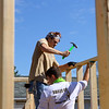 Purdue students Jackson Spurling hammers a nail with help from Benjamin Shelton as they volunteer to work on Habitat for Humanity's new build on North Locke Street on Saturday, May 1, 2021.<br /> Kelly Lafferty Gerber | Kokomo Tribune