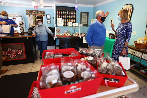5-5-21<br /> Lt. Governor Suzanne Couch, stopped by the Popcorn Cafe. Owner Grace Jones watches as she talks with State Rep. Mike Karickhoff after her purchase of popcorn.<br /> Tim Bath | Kokomo Tribune