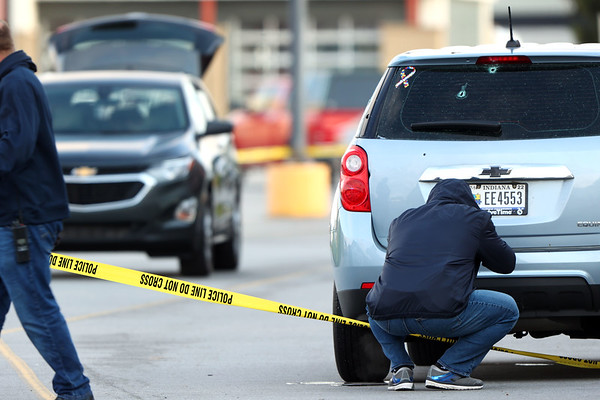 5-9-21 Kokomo Police investigate a shooting that started outside Chuck E Cheese and ended in front of BW3 in the Kokomo Town Center. Bullet holes clearly visible on the back of a Chevy Equinox that the detectives are photographing. Tim Bath | Kokomo Tribune