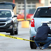 5-9-21<br /> Kokomo Police investigate a shooting that started outside Chuck E Cheese and ended in front of BW3 in the Kokomo Town Center. Bullet holes clearly visible on the back of a Chevy Equinox that the detectives are photographing.<br /> Tim Bath | Kokomo Tribune