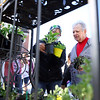 Angela Peterson from Creative Farming, left, shows plants to Carolyn LaLonde on opening day for the Kokomo Downtown Farmers Market Saturday, May 1, 2021.<br /> Kelly Lafferty Gerber | Kokomo Tribune