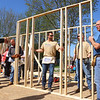 The largest group of volunteers Habitat for Humanity has had in well over a year, including members of the Kokomo Police Department, work on the organization's new build on North Locke Street on Saturday, May 1, 2021.<br /> Kelly Lafferty Gerber | Kokomo Tribune