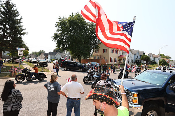 9-12-21 Marine Corps Cpl. Humberto Sanchez's body is flown into Grissom ARB and taken to Logansport in a procession that included over 6000 motorcycles on Sunday. Thousand lined East Market Street to pay their respects until the hour long procession passed by. Tim Bath | Kokomo Tribune