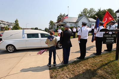 9-12-21 Marine Corps Cpl. Humberto Sanchez's body is flown into Grissom ARB and taken to Logansport in a procession that included over 6000 motorcycles on Sunday. The honor guard stands at attention outside the funeral home. Tim Bath | Kokomo Tribune