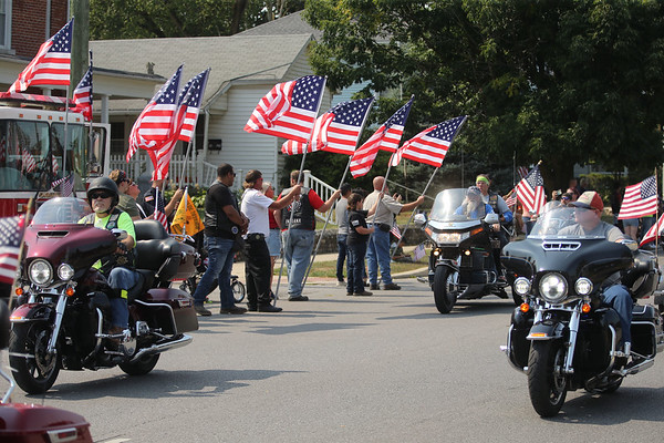 9-12-21<br /> Marine Corps Cpl. Humberto Sanchez's body is flown into Grissom ARB and taken to Logansport in a procession that included over 6000 motorcycles on Sunday. Thousand lined East Market Street to pay their respects until the hour long procession passed by.<br /> Tim Bath   Kokomo Tribune