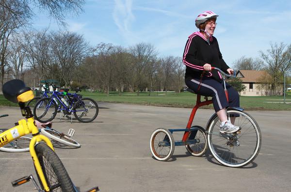 4-27-13<br /> Tour de Kokomo<br /> Corina LaFleur rides one of Tom Miller's tricycles at Foster Park before Tour de Kokomo on Saturday morning.<br /> KT photo | Kelly Lafferty