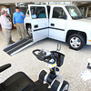 4-23-14<br /> Adams Auto Group<br /> Aaron Adams (right) talks with Briarn Walker about the MV-1, a wheelchair accessible vehicle that Adams Auto Group has added to their business, along with mobility scooters.<br /> Kelly Lafferty | Kokomo Tribune