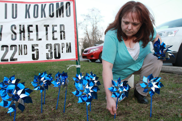 4-8-14<br /> Pinwheels for Prevention<br /> Bendi Grawcock plants a pinwheel in front of Family Service Association on Tuesday evening for Pinwheels for Prevention.<br /> Kelly Lafferty | Kokomo Tribune