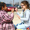 4-11-14<br /> Dream Makers day care<br /> Terriyah Finley and Kaedy Merriweather play a singing rhyme hand clap game outside of Dream Makers Day Care.<br /> Kelly Lafferty | Kokomo Tribune
