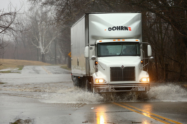 4-3-14<br /> A semi makes its way through a flooded area of Markland, near Berkley, right before officials closed the road due to high waters on Thursday morning.<br /> KT photo | Kelly Lafferty