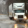4-3-14<br /> A semi makes its way through a flooded area of Markland, near Berkley, right before officials closed the road due to high waters on Thursday morning.<br /> KT photo   Kelly Lafferty