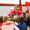 4-2-14   --- Taylor Primary School held a learning convocation to teach students what they can learn from the way Ryan Beining lived. Ryan's teacher, Sara Underwood, helps the his classmates finish up a teaching skit about passing on love. -- <br />   Tim Bath | Kokomo Tribune