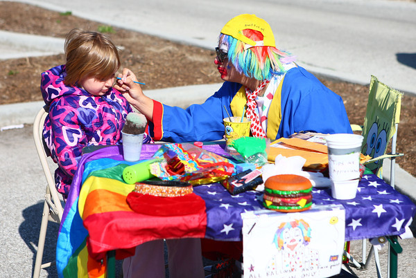 4-19-14<br /> Farmers Market<br /> Adryanna gets her face painted by Mr. Bonkers the clown at the opening day of Kokomo's Farmers' Market.<br /> Kelly Lafferty | Kokomo Tribune