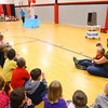 4-2-14   --- Taylor Primary School held a learning convocation to teach students what they can learn from the way Ryan Beining lived. Ryan's mom Anita and brother Zachary watch Ryan's old classmates act out different teaching scenarios. -- <br />   Tim Bath   Kokomo Tribune