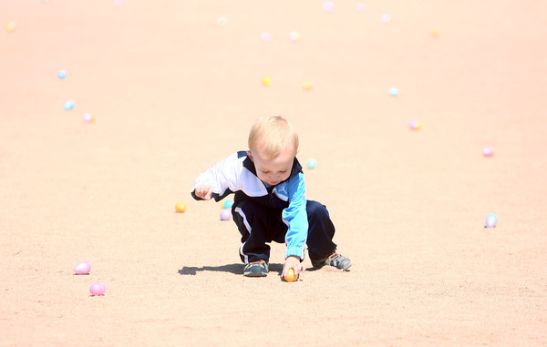 4-19-14<br /> Easter Egg Hunt at Northwest Park<br /> 19-month-old Cole McKibben makes his way to the infield to grab some Easter eggs at Northwest Park on Saturday.<br /> Kelly Lafferty | Kokomo Tribune