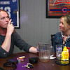 4-25-14<br /> Jack Paul smokes as he talks with Nicci Kucholick at Mulligans Sports Pub.<br /> Kelly Lafferty | Kokomo Tribune