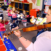 4-21-14   --- Wallace School of Integrated Arts teacher Keisha Cook teaching kids violin to second graders. -- <br />   Tim Bath | Kokomo Tribune
