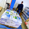 4-28-14   --- Beck's Hybrids located in Hamilton county will be expanding and creating more jobs. Jeff Humburg wrapping seed up for shipping in  the warehouse. -- <br />   Tim Bath | Kokomo Tribune