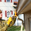 4-10-14<br /> Tornado cleanup over spring break<br /> Jason VanDoornik hammers a nail onto an outdoor shed as he repairs the gutter on it. VanDoornik was in Kokomo during his Spring Break, along with others from Ward Church in Northville, Mich. to volunteer by helping clean up around homes that were affected by November's tornado.<br /> Kelly Lafferty | Kokomo Tribune