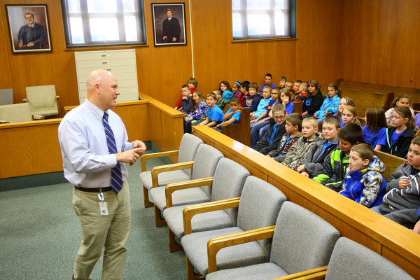 3-17-14   --- Western Intermediate School 3rd graders tour the Howard County Courthouse and get a drug dog demonstration from the Sheriffs department. Judge Doug Tate tells the students about the courroom and what goes on in a courtroom. -- <br />   Tim Bath | Kokomo Tribune