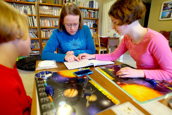 3-18-14   --- Jennifer Mayfield with her kids Katie, 9, and Anna, 11, during home school time. -- <br />   Tim Bath | Kokomo Tribune