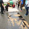 4-25-14   --- IUK students work on steamroller art. They carved artwork in a 4x8 sheet of wood, rolled ink on the plate created, placed cloth on the plywood and then rolled a steamroller over it to transfer the ink to the clothe. -- <br />   Tim Bath   Kokomo Tribune