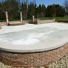 4-12-14   --- Foundation is in place for an addition to the Veterans Memorial at Darough Chapel Park. -- <br />   Tim Bath | Kokomo Tribune