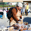 4-19-14<br /> Farmers Market<br /> Michelle Wilmoth makes her way through Kokomo's Farmers' Market on its opening day Saturday morning.<br /> Kelly Lafferty | Kokomo Tribune