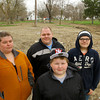 3-14-14   --- Ashley and Mark Jaimz with sons Keygan Peters, 10 and Levi Peters, 13, at the site of the house they rented for 2 years on East Murden Street before the flood in 2013. The city purchased the house and demolished it. -- <br />   Tim Bath | Kokomo Tribune