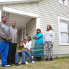 4-7-14<br /> Kendale Harris, Michael Thomas, Kushite Thomas, Keshawn Thomas, Khristen Thomas, Lashanda Thomas, and Keanna Harris outside of their Plate St. home<br /> Kelly Lafferty | Kokomo Tribune