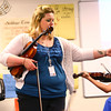 4-21-14   --- Wallace School of Integrated Arts teacher Keisha Cook teaching kids violin. -- <br />   Tim Bath | Kokomo Tribune