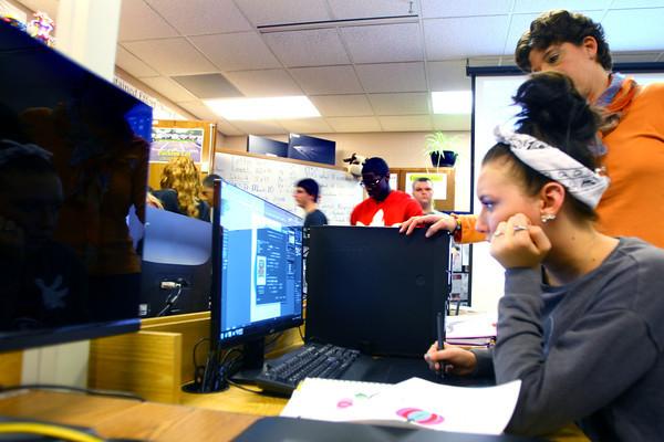 3-17-14   --- Dual Credit classes at Kokomo Area Career Center. Teacher Melissa Cohick works with junior Kirsten Kelley in the graphic design class. -- <br />   Tim Bath   Kokomo Tribune