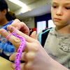 4-24-14   --- Sycamore Elementary 5th graders make bracelets to raise money for Relay for Life. Jaylan Hinton, working on one of the rubberband bracelets.  -- <br />   Tim Bath | Kokomo Tribune