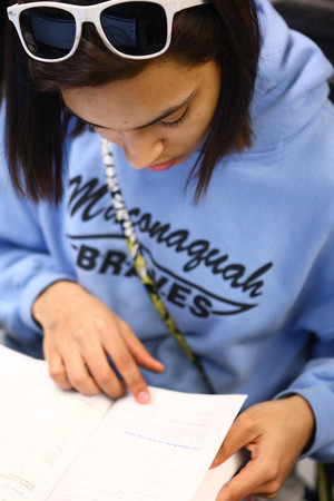 4-9-14<br /> First generation college student, Keeana Walton<br /> IUK student Keeana Walton looks up information during a group activity in her English class.<br /> Kelly Lafferty | Kokomo Tribune
