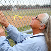 4-2-14<br /> Ryan Beining memorial service<br /> Glenda Walker pats the yellow ribbon she tied on the fence of Ryan's Field, Taylor Intermediate's baseball field named after Ryan Beining.<br /> KT photo | Kelly Lafferty