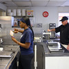 4-17-14<br /> Kokomo frozen custard<br /> Kahdijah Brooks makes a cone at Kokomo Frozen Custard as her boss, and owner of Kokomo Frozen Custard, Mike Hinkle, works the frozen custard-making machine.<br /> Kelly Lafferty | Kokomo Tribune