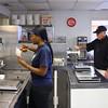 4-17-14<br /> Kokomo frozen custard<br /> Kahdijah Brooks makes a cone at Kokomo Frozen Custard as her boss, and owner of Kokomo Frozen Custard, Mike Hinkle, works the frozen custard-making machine.<br /> Kelly Lafferty | Kokomo Tribune