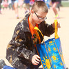 4-19-14<br /> Easter Egg Hunt at Northwest Park<br /> 10-year-old Karson Kirby places his Easter eggs in his bag during the Easter Egg hunt at Northwest Park on Saturday afternoon.<br /> Kelly Lafferty | Kokomo Tribune