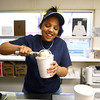 4-17-14<br /> Kokomo frozen custard<br /> Paris Roney scoops frozen custard into a container at work. Roney has worked at Kokomo frozen custard for seven years.<br /> Kelly Lafferty | Kokomo Tribune