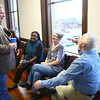 4-17-14<br /> New Kokomo Democrat headquarters<br /> Cass County Democratic chairman Paul Ulerick talks to Carment Ferguson (left), Devonya Collins-Shuck, and Paul Shuck, inside the new Howard County Democrat headquarters.<br /> Kelly Lafferty | Kokomo Tribune