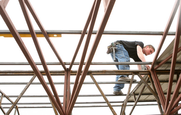 4-10-14<br /> Rebuilding Peru's BK<br /> Nate Walter works on putting up roofing over BK in Peru, as they rebuild it after it was damaged in July's tornado.<br /> Kelly Lafferty | Kokomo Tribune