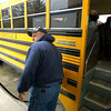 4-2-14   --- Sharpsville in northern Tipton County.  Jay Rayl pumps gas in a Tri-Central school bus at the convenient store in Sharpsville. -- <br />   Tim Bath | Kokomo Tribune