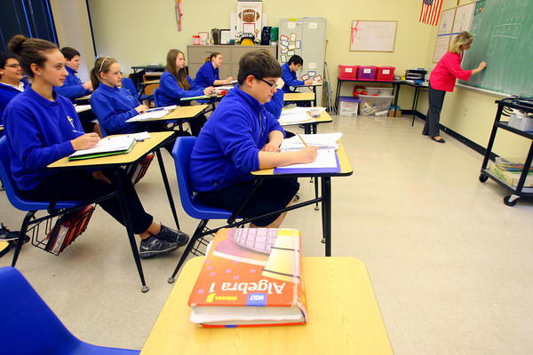 4-2-14   --- Sts. Joan of Arc & Patrick School 8th graders in Mrs Cindy McClure's math class where they have gone 100 days without missing a homework assignment. -- <br />   Tim Bath | Kokomo Tribune