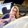 3-17-14   --- Dual Credit classes at Kokomo Area Career Center. Sophmore Kayla Miller sands an auto body during a 2nd year Collison Repair coarse with instructor Richard Shoffner. -- <br />   Tim Bath | Kokomo Tribune