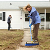 4-10-14<br /> Tornado cleanup over spring break<br /> Shelly Jones sweeps the front walk way as Greenlea Becktold rakes the front yard of a home on Poplar Street that was affected by November's tornado. They were there during their Spring Break from Ward Church, located in Northville, Mich.<br /> Kelly Lafferty | Kokomo Tribune