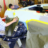 3-17-14   --- Dual Credit classes at Kokomo Area Career Center. Sophmore Dylan McKoon and junior Trent VanMeter mask sections of a fiberglass boat for painting during a 2nd year Collison Repair coarse with instructor Richard Shoffner. -- <br />   Tim Bath | Kokomo Tribune