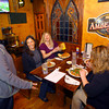 4-25-14   --- Smitty McMusselman's Pub & Grub in Peru at 202 South Broadway. Co-owner Christina Smith joking around with customers Shine Ansari, Jamie Ross, Nikki Sparks and Sara Eiler. -- <br />   Tim Bath | Kokomo Tribune